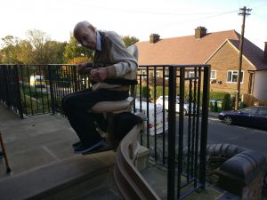 external stairlift on curved staircase outdoors